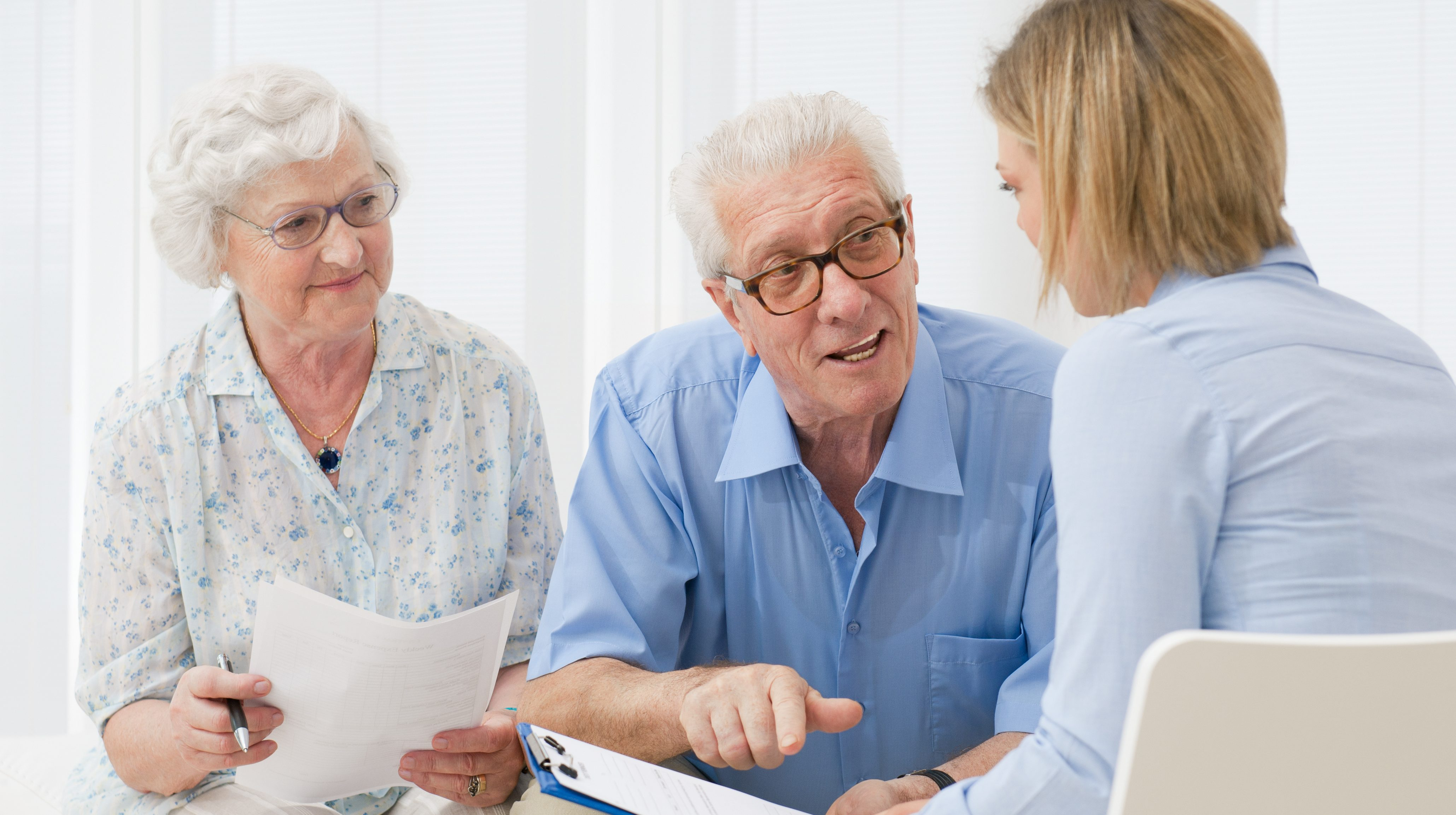 Three people sitting discussing home health care
