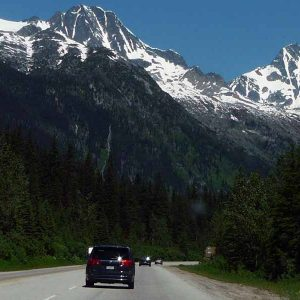 Car Driving toward mountain on road